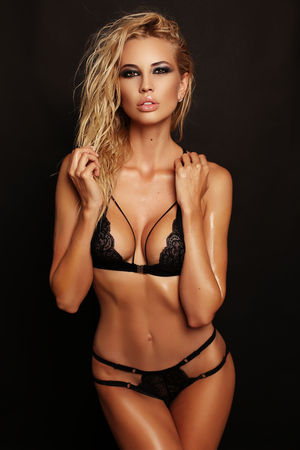 fashion studio photo of gorgeous sexy woman with blond hair wears luxurious lace black lingerie Stock Photo