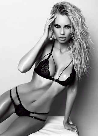 luxurious: fashion studio photo of gorgeous sexy woman with blond hair wears luxurious lace black lingerie Stock Photo