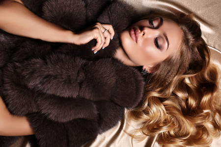luxurious: fashion studio photo of gorgeous sensual woman with blond hair in luxurious dress and fur coat