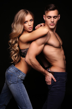 fashion studio photo of sexy beautiful couple. gorgeous woman with blond hair and handsome man Stock Photo