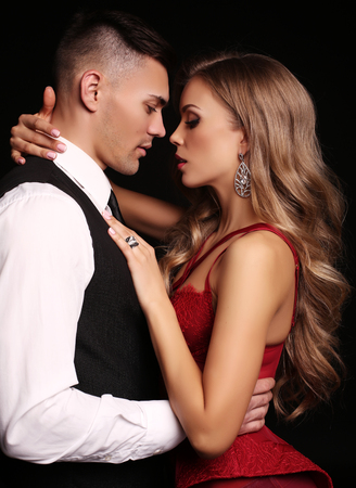 fashion studio photo of sensual beautiful couple. gorgeous woman with blond hair and handsome man
