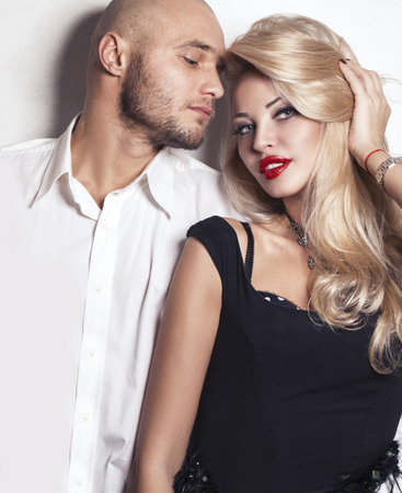 impassioned: fashion studio photo of impassioned couple. gorgeous woman with blond hair posing with handsome man