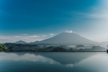 series travels. beautiful view on fantastic volcano Agung in Bali from swimming pool