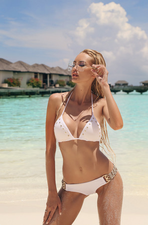 fashion photo of beautiful sexy woman with blond hair in elegant swimming suit relaxing on Maldive islands Stock Photo