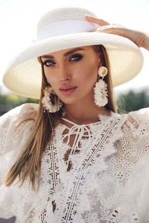 fashion outdoor photo of beautiful girl with blond hair in elegant clothes and accessories Stock fotó - 129005101