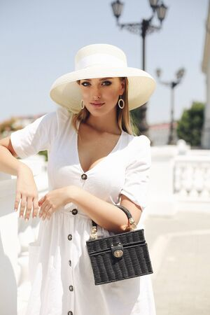 fashion outdoor photo of beautiful girl with blond hair in elegant clothes and accessories Stock fotó - 129005296