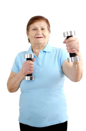 A mature woman is doing a workout with dumbbells and is having fun  photo