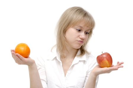 A beautiful young girl doesn't like the apple. She has made her decision. Stock Photo