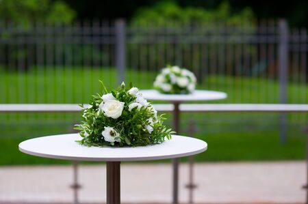 flower arrangement on a buffet table on the street and in the background is another Reklamní fotografie - 129374936