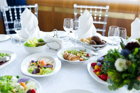 several salads on a white table in a restaurant