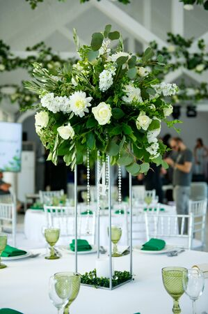 simple flower arrangement on a table outdoors