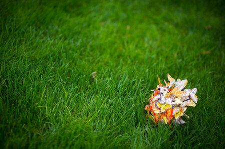 artificial bride s bouquet of artificial butterflies lies on a lawn. copy space