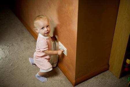 Baby girl and power outlet, dangerous games, life threatening.