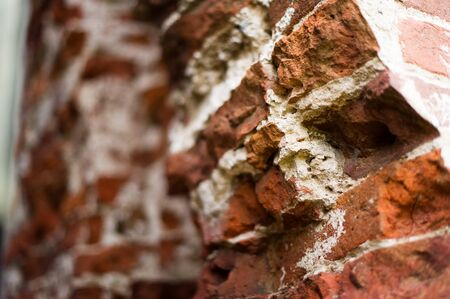 pillar, part of an antique building with a crumbling brick. close up Imagens
