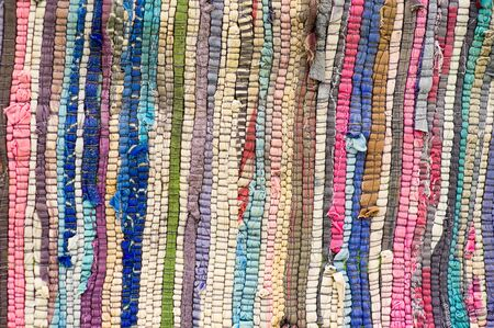 texture of woven fabric from fragments of different colors