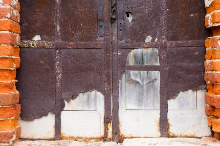 blocked entrance to an abandoned antique building with crumbling walls. Close-up