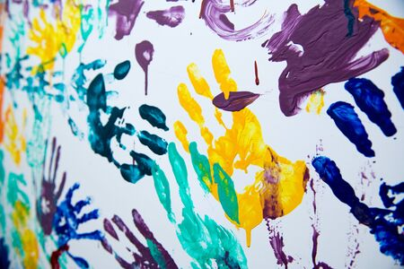 color handprints on the wall, close up