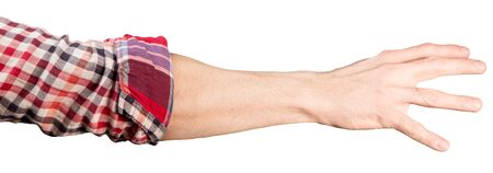 a man's hand in a rolled-up shirt sleeve reaches for something, isolated