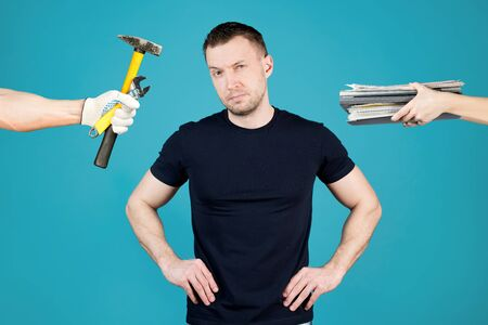 a sports man with a serious face personifies the choice of a profession - physical or intellectual labor. He is offered documents and folders on the one hand and work tools on the other