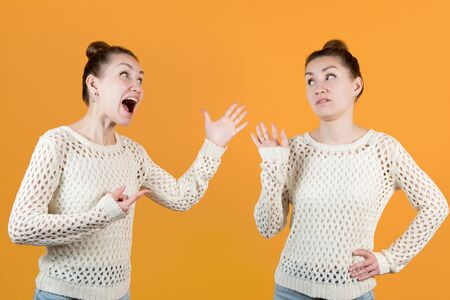 Split personality. The woman resists the fact that the woman herself scolds and screams. Both people are the same face, montage on an orange background