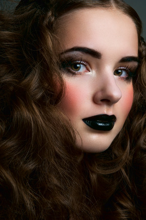 blush: Brunette girl with black lips and blush