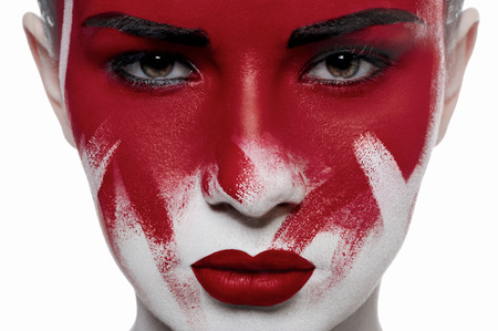 beauty: Halloween beauty makeup. Girl with red lips and blood on face Stock Photo