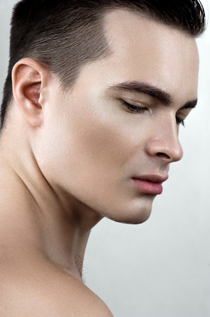 perspiring: Beauty male model with drops on face Stock Photo