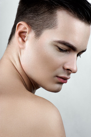 perspiring: Fashion beauty male with drops on face
