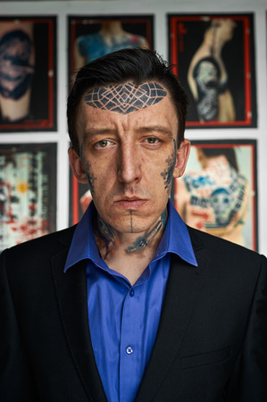 Portrait of tattoo artist in black jacked and blue shirt Stock Photo