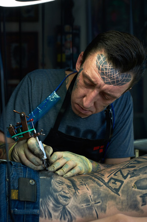 master: Closeup portrait of tattoo master Stock Photo