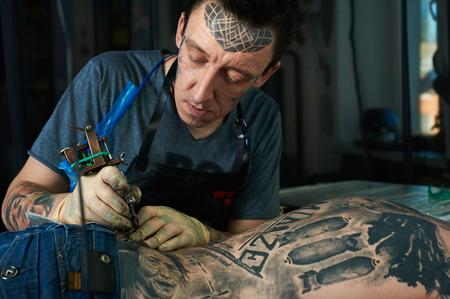 master: Tattoo master working in studio
