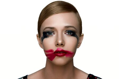smeared: Beauty and health clean Skin of sad young female Model with smoky Eyes and red Lips with smeared Mascara and Lipstick. Stock Photo
