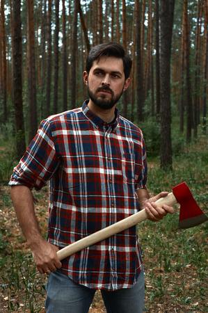 lumberman: Bearded Lumberjack with a big Ax in Hands Stock Photo