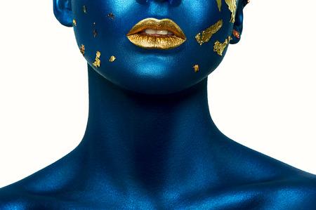 Beauty fashion Girl with blue Skin and gold Lips. Halloween Makeup Reklamní fotografie