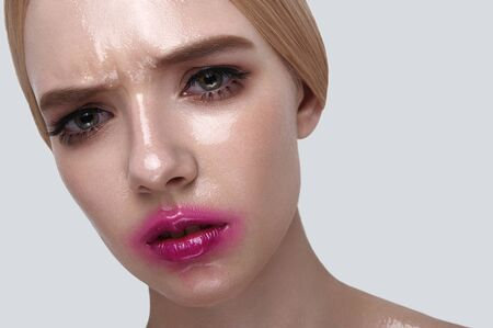 wet lips: Serious female Model with wet Face and pink Lips Stock Photo
