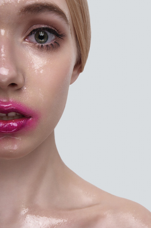 wet lips: Half Face of surprised beauty Model with wet Skin and pink Lips