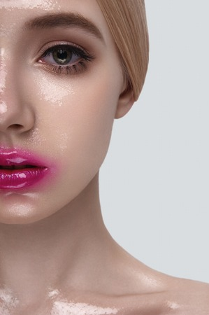 wet lips: Half Face of fashion beauty blonde Model with wet Skin and pink Lips