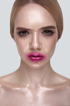 wet lips: Serious beauty Girl with wet perfect Skin and pink Lips