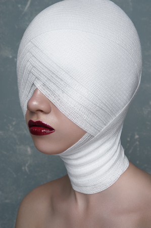 white bandage: Female Patient with medical white Bandage on her Face