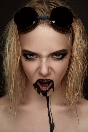 paint drips: Beauty Girl with black Paint Drips on her opened Mouth
