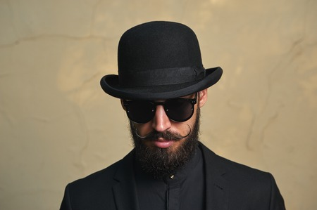bowler: English modern Man with Bowler Hat, Beard and Mustaches