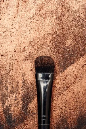 smeared: Beauty Brush on golden smeared Background