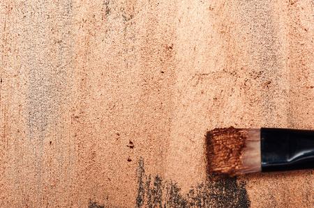 smeared: Beauty Brush on shiny smeared Surface Stock Photo