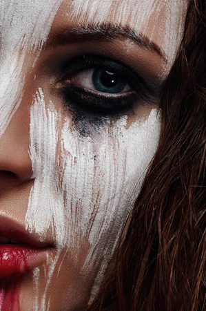 smeared: Beautiful Face with white smeared Paint