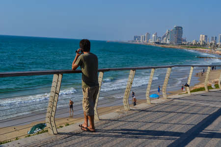 Man using mobile phone on the beach Stock Photo