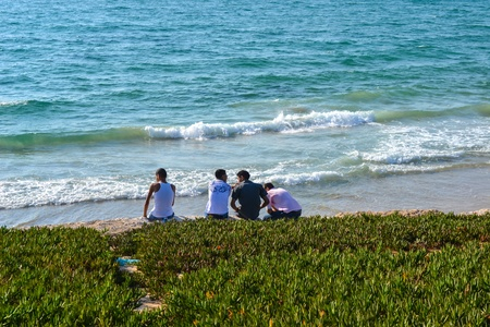 A group of friends talking at the beach in Tel Aviv photo
