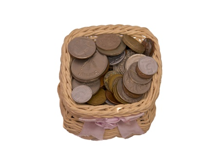 Wooden vase with metal money isolated on a white background. Stock Photo