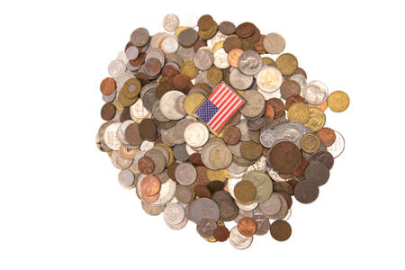 American flag on a  pile of coins isolated on white background Stock Photo