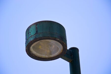 Old lamp against blue sky