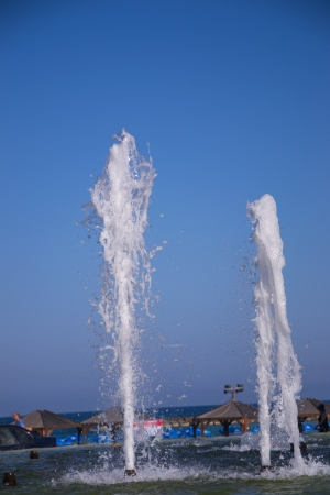 Splashes of fountain water in a fine day photo